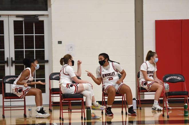 Sewickley Academy's bench sits spaced apart during Friday night's game against Eden Christian Academy at Sewickley Academy.