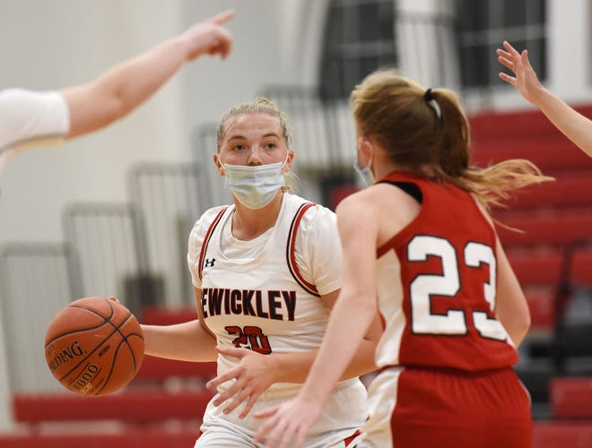Sewickley Academy's Kamryn Lightcap looks to pass around Eden Christian Academy's Katie Kirby during Friday night's game at Sewickley Academy.