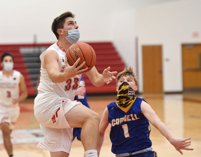 Sewickley Academy's Nick Wilson shoots in front of a Cornell defender in a game played just before the statewide shutdown order took effect. With the order expiring Monday, games could be played again as soon as Friday, Jan. 8.