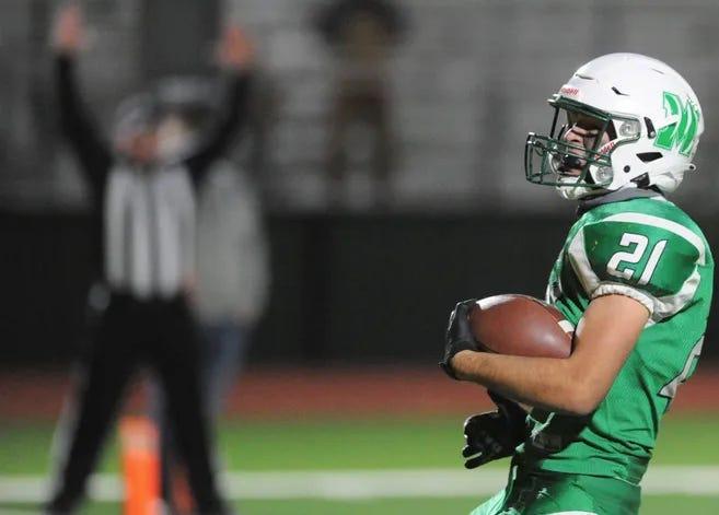 May senior Corbin Bass runs for a touchdown against Blum on Dec. 5.