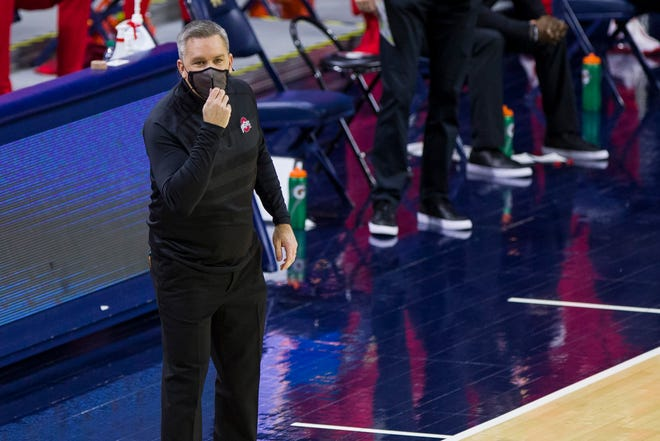 Ohio State head coach Chris Holtmann yells to his players during the first half of an NCAA college basketball game against Notre Dame on Tuesday, Dec. 8, 2020, in South Bend, Ind. Ohio State won 90-85. (AP Photo/Robert Franklin)