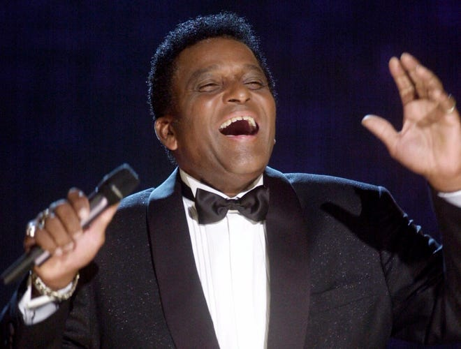 Charley Pride, the first Black country music superstar, performs during his induction into the Country Music Hall of Fame at the Country Music Association Awards show at the Grand Ole Opry House in Nashville, Tenn. , on Oct. 4, 2000. He died Dec. 12, 2020 of complications from COVID-19.