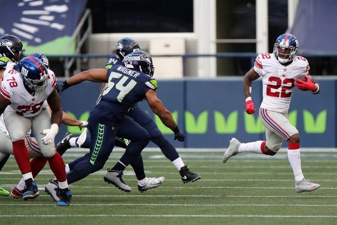 New York Giants running back Wayne Gallman breaks away for a 60-yard run against the Seattle Seahawks last Sunday.