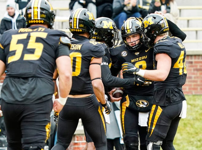 Missouri quarterback Connor Bazelak (8) is congratulated by teammates after scoring a touchdown during a game against Georgia this season.