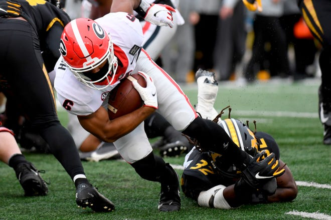 Georgia running back Kenny McIntosh (6) is pulled down by Missouri linebacker Nick Bolton (32) during a game Saturday at Faurot Field.