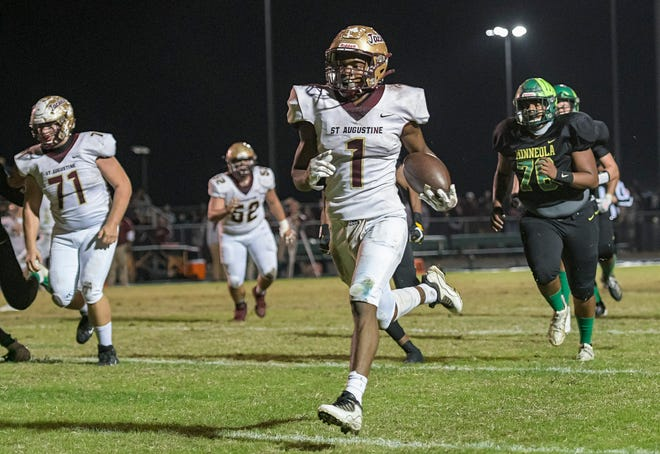 St. Augustine's Dequan Stanley (1) scores during Friday's Class 6A state semifinal against Lake Minneola at the Hawks Nest in Minneola.