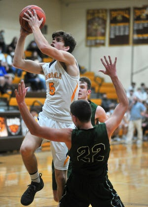 Waynedale's Zach Geiser finishes through contact to score two of his 12 first-quarter points. Geiser scored a game-high 33 points.