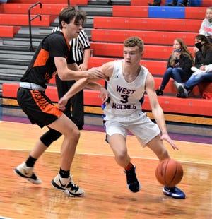 Garrett Eastep drives past Mount Vernon's Dayne Burgess on the baseline on his way to two of his team-high 13 points.