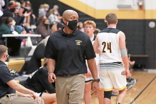 New London High School boys basketball coach Bryant Porter picked up his 100th career win Friday against Van Buren County.