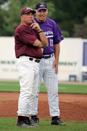 Mount Pleasant High School baseball coach Mike Henderson talks with Burlington coach Dan Reid June 12, 2005, prior to the start of the first game of a double header between Burlington High School and Mount Pleasant High School at Community Field.