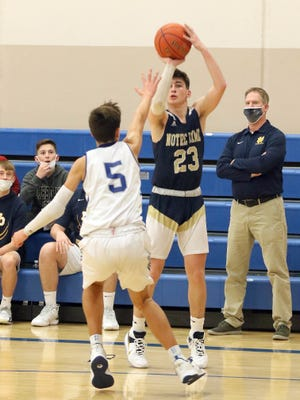 Notre Dame's Jackson Brent (23) fires for three over Danville's Caiden Gourley (5) Friday in Danville.