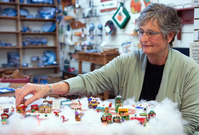 Mills River resident and bead jewelry artist Barbara Wilcox spent more than 300 hours putting together a Christmas village display made almost entirely of tiny beads she sewed together by hand using bead needles and fishing line.