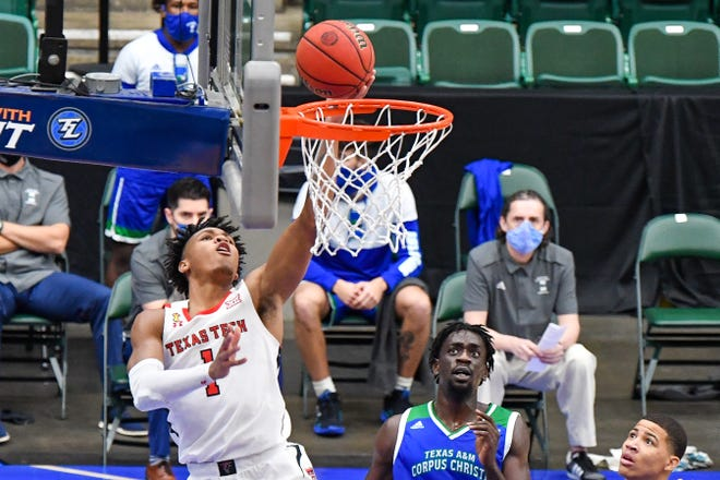 Texas Tech's Terrence Shannon Jr. (1) drives to the basket during the first half of a nonconference basketball game Saturday against Texas A&M-Corpus Christi at the Comerica Center in Frisco, Texas. Shannon finished with a game-best 15 points to lead the No. 17 Red Raiders to a 77-57 win.