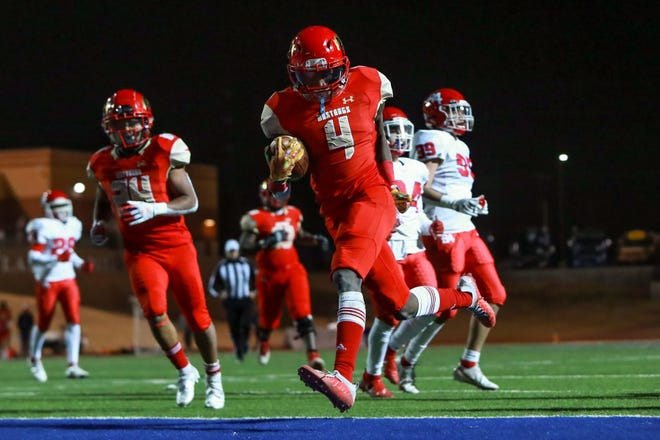 Coronado's Ke'Vondrick Carr (4) scores a touchdown against El Paso Bel Air during the Class 5A, Division I bi-district game on Dec. 11 at Plains Capital Park at Lowrey Field.