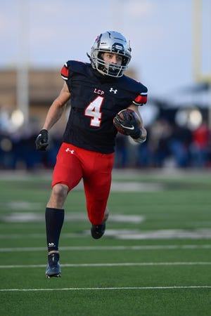 Lubbock-Cooper's Rylan Wilcox returns the opening kickoff 87 yards for a touchdown in the Pirates' 52-0 bi-district victory Friday night against visiting Fort Worth Polytechnic. Wilcox returned a punt for a touchdown moments four minutes after the kick-return touchdown.