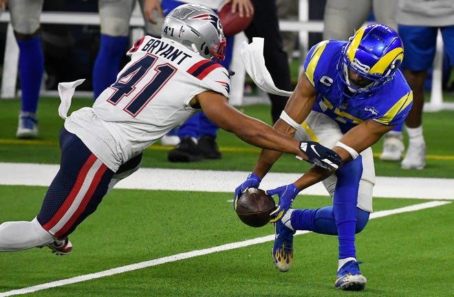 Rams wide receiver Robert Woods (right) makes a fingertip catch before Patriots cornerback Myles Bryant  stripped the ball away from Woods for an interception at SoFi Stadium in Inglewood, Calif.  [Robert Hanashiro-USA TODAY Sports File Photo]