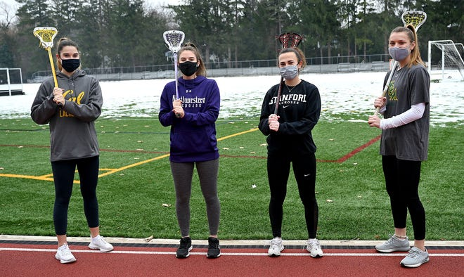 From left to right Brooke Baker, a sophomore at University of California, Maddy Balter, a sophomore at Northwestern, Caitlin Chicoski, a junior at Stanford and Grace Ahonen, a junior at William & Mary, all played lacrosse for Wellesley High School.