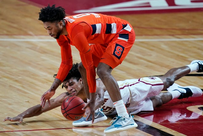Boston College guard Demarr Langford Jr. (15) dives but Syracuse forward Alan Griffin (0) controls the ball during the second half Saturday in Chestnut Hill, Massachusetts. Syracuse won 101-63.