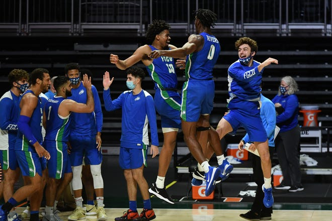 Florida Gulf Coast players celebrate after upsetting Miami in Coral Gables on Saturday.