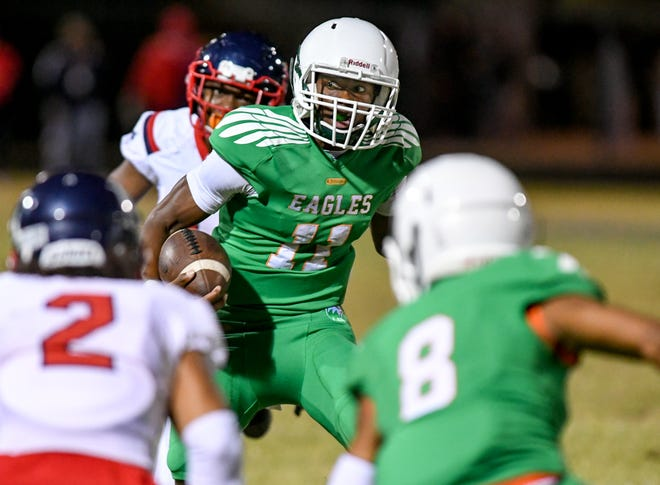 Atlantic High School quarterback Guenson Alexis (11) rushes during a 46-21 victory over the Miramar Patriots in the Class 7A gold bracket semifinal game in Delray Beach, FL, on Friday, December 11, 2020.