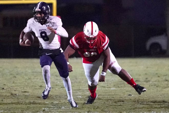 Dwyer quarterback Tre'Von Taylor runs away from a Plantation defender on Friday. Taylor tossed three touchdown passes, but the Panthers lost 41-27.
