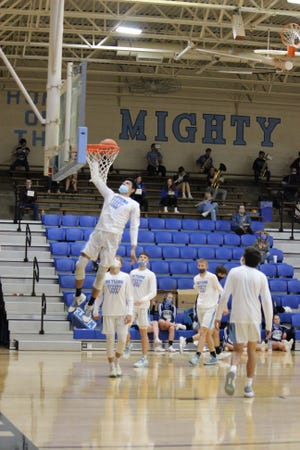 Eliazar Carrasco goes up high for a layup during early-season pre-game warmup for the Skyline High School basketball team.