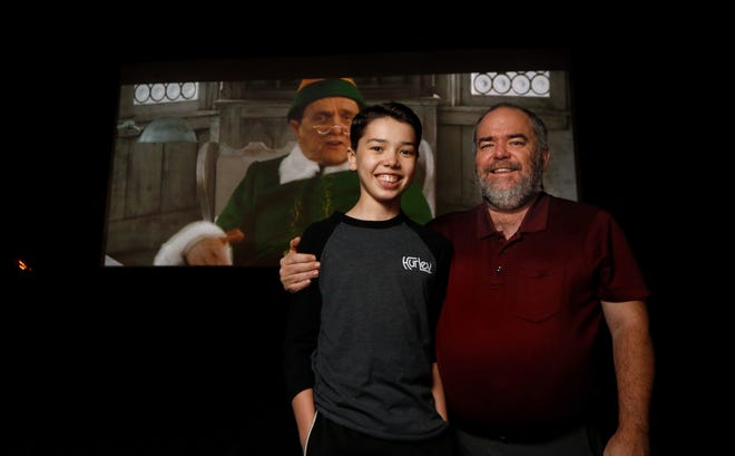 """Paul Edward Parker and his son Jeremiah, 13, at the Rustic Tri View Drive In on a recent Friday evening to see """"Elf."""" They became regulars at the Route 146 drive-in, taking in movies 18 weekends between May and December."""