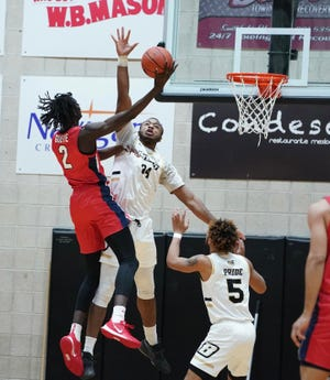 Bryant's Hall Elisias tries to block the shot of Stony Brook's Mouhamadou Gueye during Saturday's game.