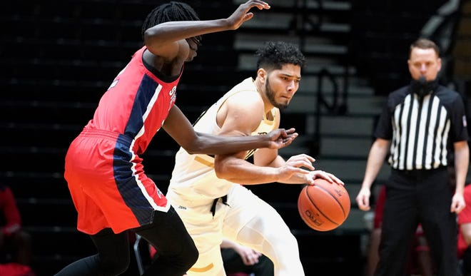 Bryant's Luis Hurtado tries to make his way past a Stony Brook defender during the Bulldogs' win on Saturday.