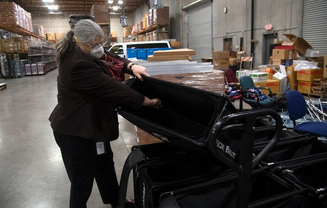 San Joaquin County Registrar of Voters Melinda Dubroff checks out a ballot box during a final walk through of voting equipment at the registrar's warehouse at the Stockton Metropolitan Airport.