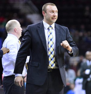 Northern Kentucky assistant coach Eric Haut, a former standout player and long-time assistant coach at Kent State, will be on the visitor's bench at the M.A.C. Center on Sunday. Haut is pictured while serving as an assistant for the Golden Flashes under head coach Rob Senderoff (background).
