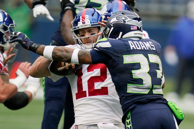 Seattle Seahawks strong safety Jamal Adams (33) sacks New York Giants quarterback Colt McCoy during the first half of their Dec. 6 game in Seattle.