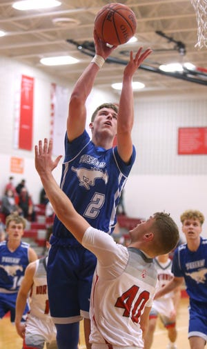 Nate Frascone (2) of Tuslaw takes a shot while being guarded by Isaac LaFay (40) of Northwest during their game at Northwest on Friday, Dec. 11, 2020.
