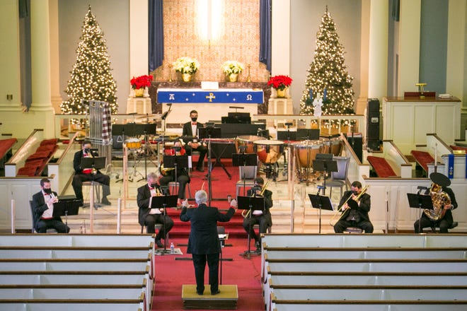 Steven Larsen, center, the music director of the Rockford Symphony Orchestra, directs the Holiday Pops Concert at Trinity Lutheran Church on Saturday, Dec. 12, 2020, in Rockford. The concert was filmed and recorded for television broadcast on Christmas Day.