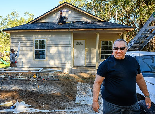 In this file photo, Jerry Folckemer, owner of Old City Homes, walks from a two-bedroom, 800-square-foot home he is building in West Augustine on Friday, Dec. 11, 2020.