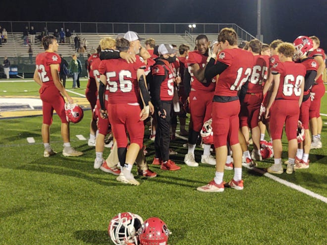 Savannah Christian players gather on the field and console each other after a dramatic 21-17 loss to Wesleyan in the GHSA Class A Private quarterfinals on Friday night at Pooler Stadium.