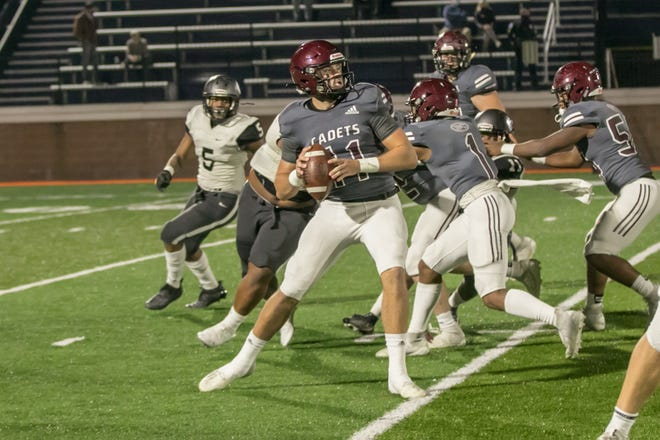 Benedictine quarterback Holden Geriner (11) looks to pass during a game against Riverside.