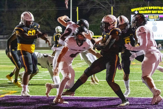 Calvary's Greg Daniel (3) scores a short rushing touchdown against George Walton Academy on Friday night at Calvary Day  School.