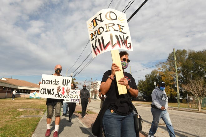 Dozens of people came out Saturday Dec. 12, 2020 in downtown Wilmington, N.C. for a rally against gun violence at the 1898 Memorial Park. The group spoke out against gun violence in our city and marched to the steps of City Hall were they continued their message.  [KEN BLEVINS/STARNEWS]