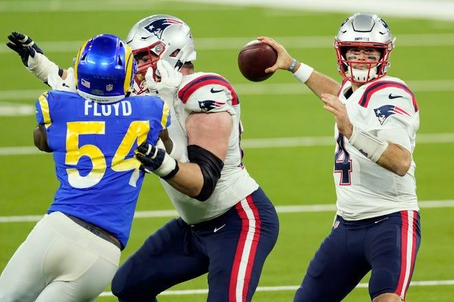 New England quarterback Jarrett Stidham throws a pass during Thursday's game.