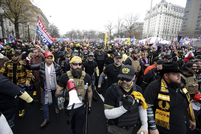 Supporters of President Donald Trump who are wearing attire associated with the Proud Boys attend a rally at Freedom Plaza Saturday in Washington.