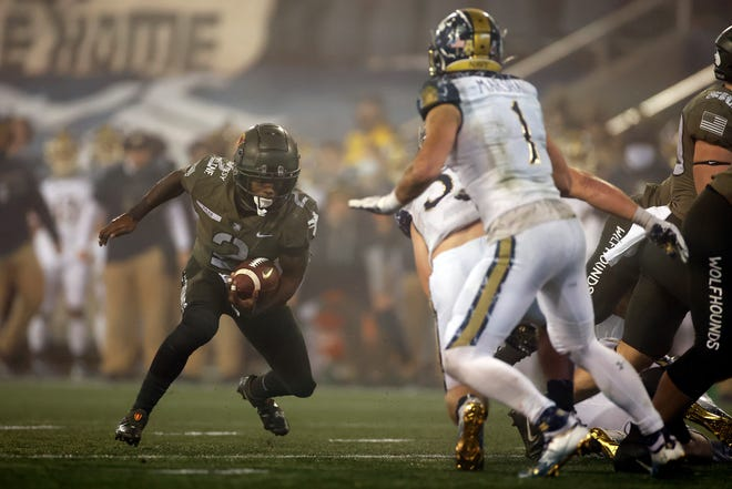 Army quarterback Tyhier Tyler rushes during the second half of Saturday's game.