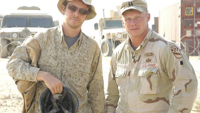 """Jake Rademacher, left, spent time in Iraq with his brother, Isaac, while making the documentary, """"Brothers at War."""" [File photo]"""