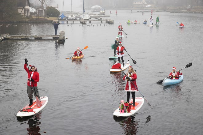 Santa's helpers took to Greenwood Lake Saturday for the annual Santapoloozza, a charitable event hosted by the owners of Jersey Paddle Boards in Greenwood Lake, NY.