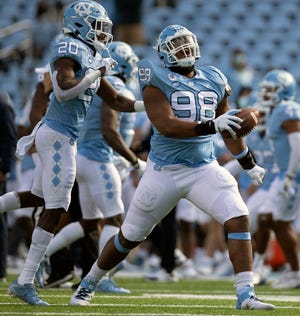North Carolina defensive lineman Kevin Hester Jr. celebrates with defensive back Tony Grimes, left, after recovering a fumble during last week's blowout of Western Carolina.