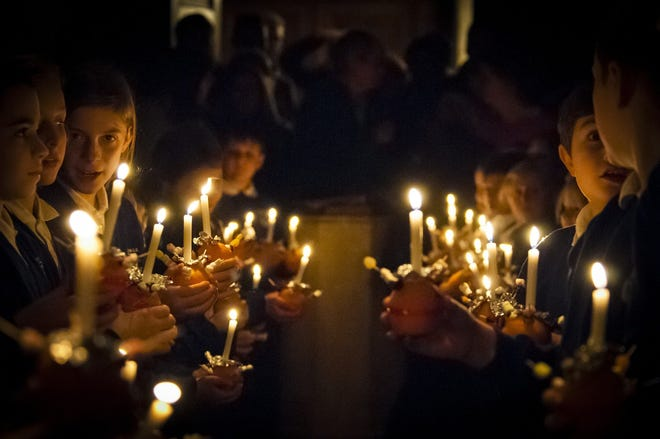 Candlelight services are always popular at Christmas.