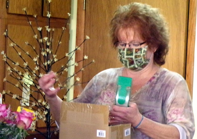 Michelle Anthony packs up a special anniversary gift for a customer.
