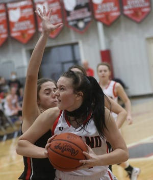Hiland's Kelsey Swihart looks to take the ball to the hoop as Tusky Valley's Sydney Clements defends in a game earlier this season.