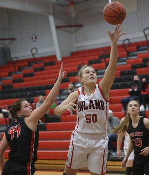 Hiland's Zoe Miller drives to the basket as Tusky Valley's Katie Burrier defends Saturday.