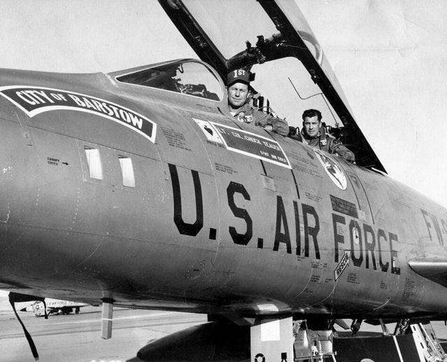"""This December 1958 photo shows Charles """"Chuck"""" Yeager, left, and Barstow Vice Mayor Jim Gilliam in the """"City of Barstow"""" aircraft during the grand opening celebration of Interstate 15 between Victorville and Barstow."""